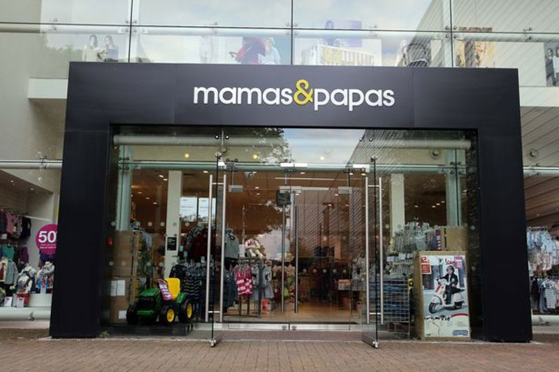 Mamas and Papas shop front. Grey shop front with green and white logo.