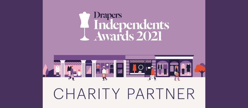 A purple background with cartoon drawings of shops and boutiques on, with drawings of people above the text which reads Drapers Independent Awards 2021.