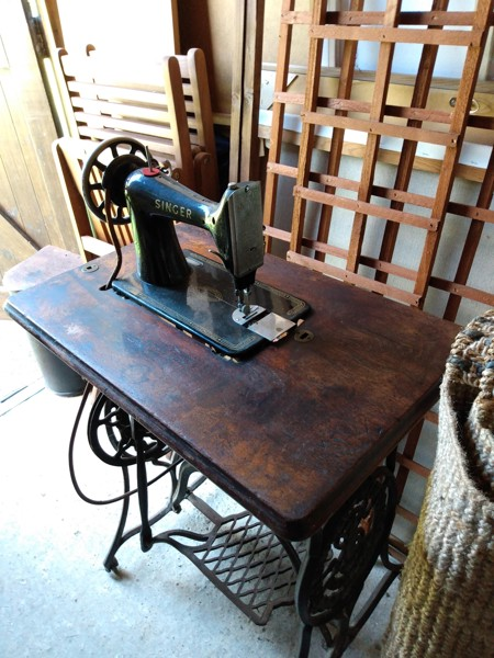 A vintage singer sewing machine is pictured sitting in our garage.