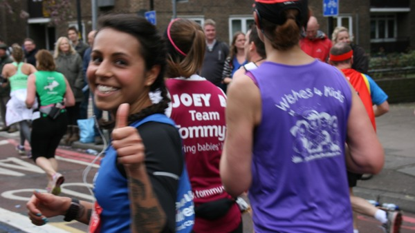 Happy marathon runner during the race.