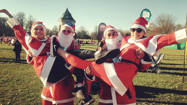 A group of our 2016 Santa Runners showing off their costumes.