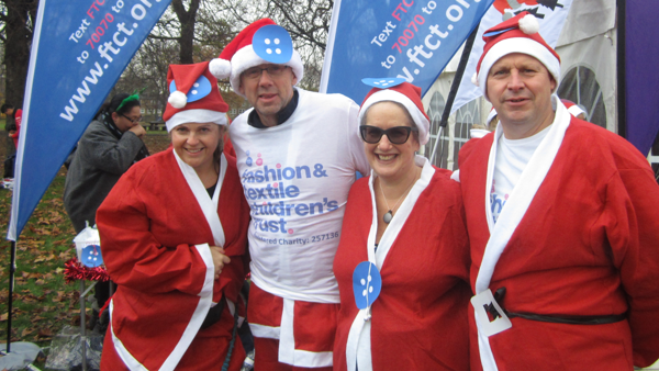 Picture of FTCT trustees at a fun run, dressed as Santa Claus.