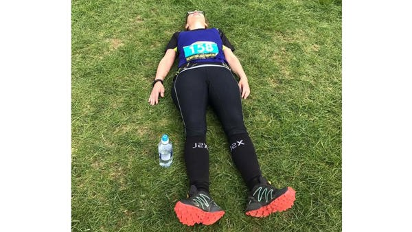 Picture of Heidi lying down flat out after running.