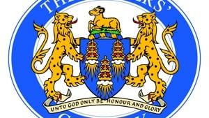 Two golden lions surround a blue crest beneath the text the drapers company.