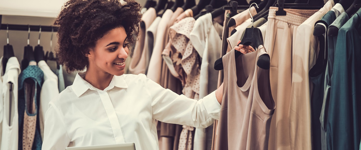 Picture of a woman working in a clothes shop.