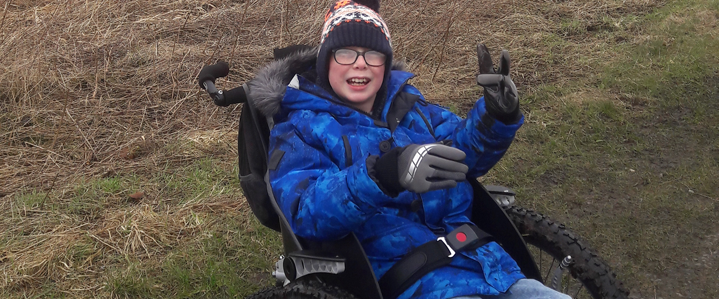 Picture of Robin in his wheelchair, funded by an FTCT grant.