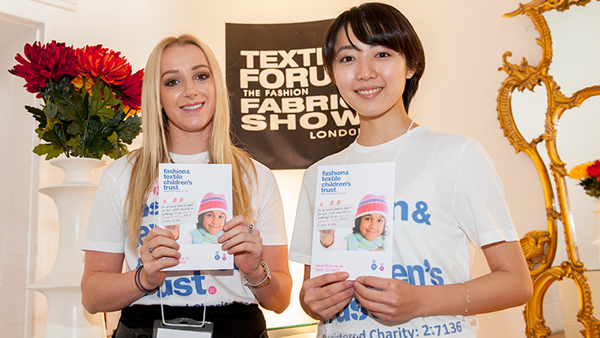 Picture of two female volunteers at a trade show.